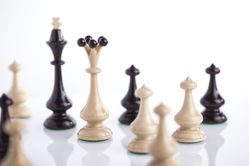 Chess pieces showing the competition, in business and game