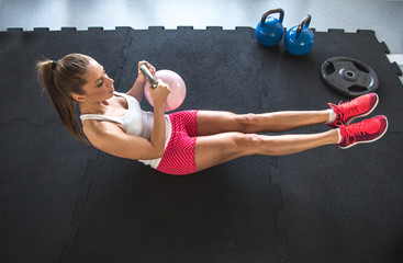 Woman working on her abs with kettlebell