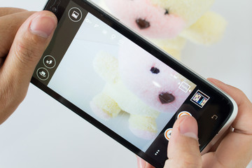 photo shooting a doll on smartphone