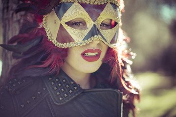 Majestic, beautiful woman with full lips and Venetian mask at su