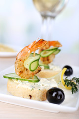Appetizer canape with shrimp and olives