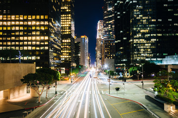 Traffic and buildings on Figueroa Street at night, in the Financ