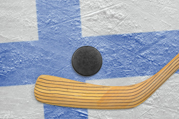 Hockey puck, hockey stick and the Finnish flag