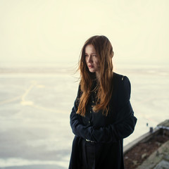 beautiful girl in a black coat. photo Gothic