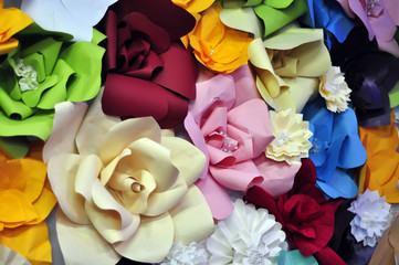 Origami paper flowers in collage