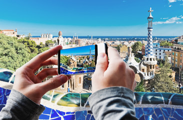 Tourist taking a picture of Park Guell in Barcelona, Spain.