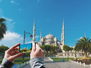 Tourist taking a picture of The Blue Mosque, Istanbul, Turkey