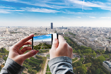Tourist taking a picture of Aerial panoramic view of Paris.