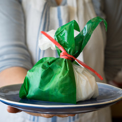 Apulien Burrata Cheese in a Bag Wrapped with a Green Leaf