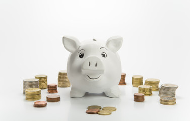 Smiling piggy bank with coins
