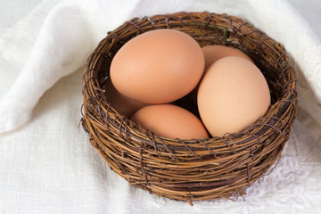 Boiled chicken eggs lying in a basket