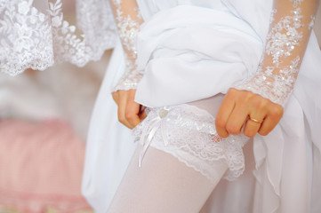 Garter on the leg of the bride