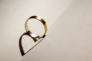 Wedding ring with heart shadow .