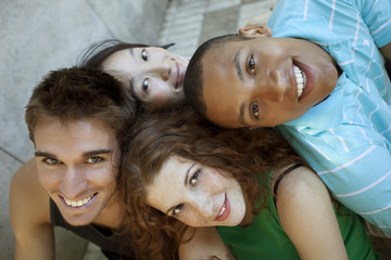 Multiethnic group of young friends having fun outdoors