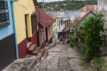 steep cobblestone street in flores guatemala