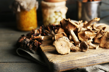 Dried mushrooms on cutting board, closeup