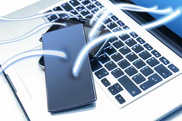smartphones on laptop keyboard