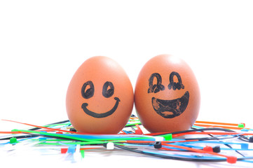 Funny smile, love and happy  egg on white background.