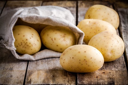 Fresh organic raw potatoes in a bag