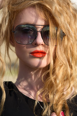 beautiful fashion model with red hair wearing glasses
