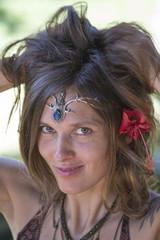 Portrait beautiful hippie girl in nature, close up