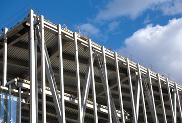 Big industrial building construction. Metal frame mounting