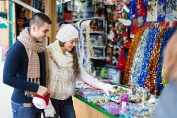 Couple choosing Christmas decoration