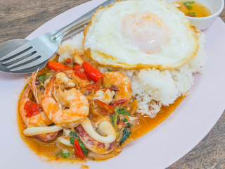 Thai food spicy squid and shrimp with fish sauce