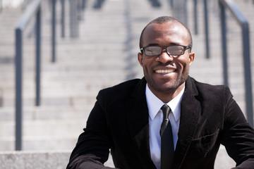portrait of sitting employee black man
