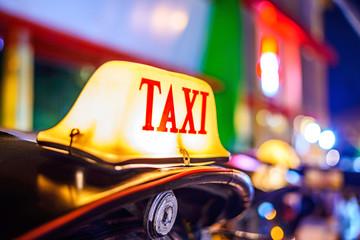 Thai Taxi (Tuk Tuk) sign with defocused lights blur , Chiang Mai