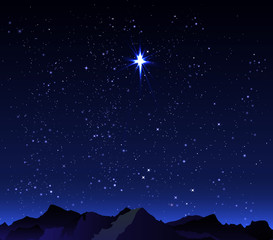Mountains in the background starry night sky with a big star