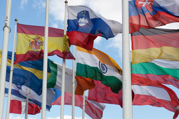Flags of the countries of the world wave on a wind