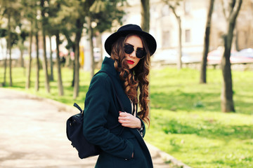 Outdoor fashion portrait of stylish pretty hipster girl