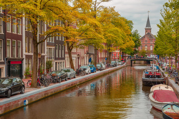 Amsterdam canal, church and typical houses, Holland, Netherlands
