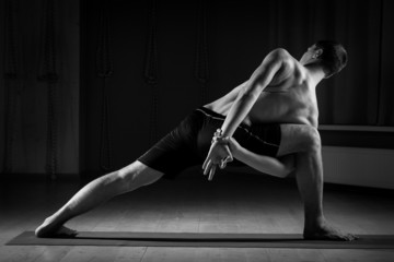 man doing yoga , black and white 3