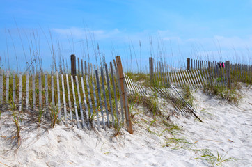 Florida Beach sand dunes with weathered fence