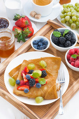 delicious breakfast - crepes with fresh berries and honey