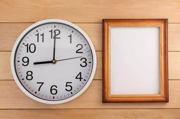 wall clock on wood