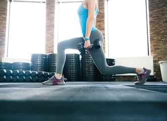 Closeup image of a woman working out with dumbbells