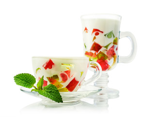 Colorful jelly dessert in a glasses with mint