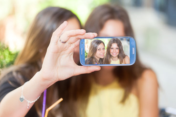Friends taking a self shot with phone