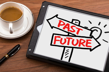 past or future on signpost hand drawing on tablet pc