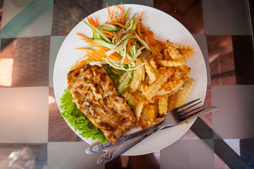 Cambodian fish barbeque with fries