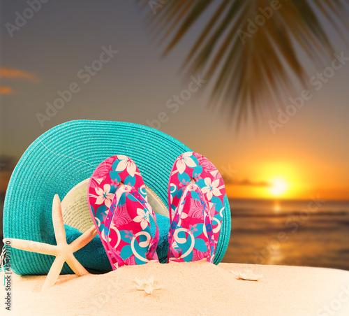 04da6cd2b flip-flops with tropical beach background