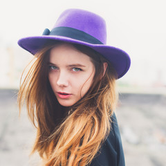 portrait of a beautiful young girl in a hat
