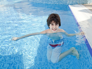Happy teen in the swimming pool