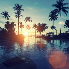 Sunset on the tropical ocean beach.