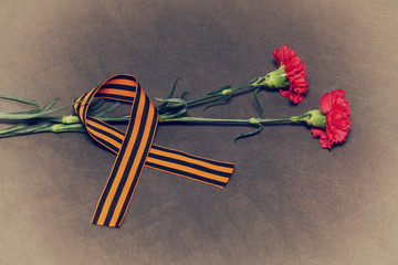 flowers and George Ribbon. Vintage Photo Victory Day on May 9