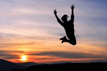 Happy girl woman jump against beautiful sunset. Freedom, enjoyment, landscape