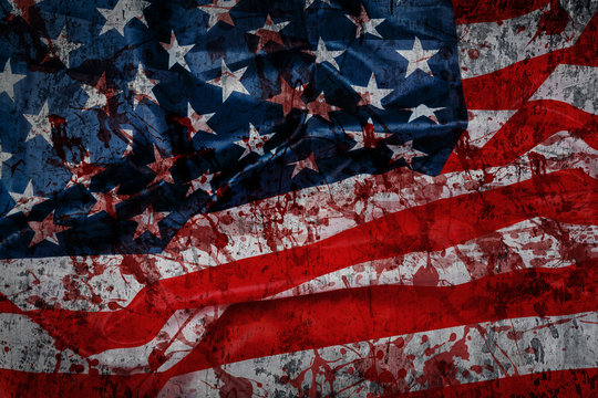 American flag with blood splatters